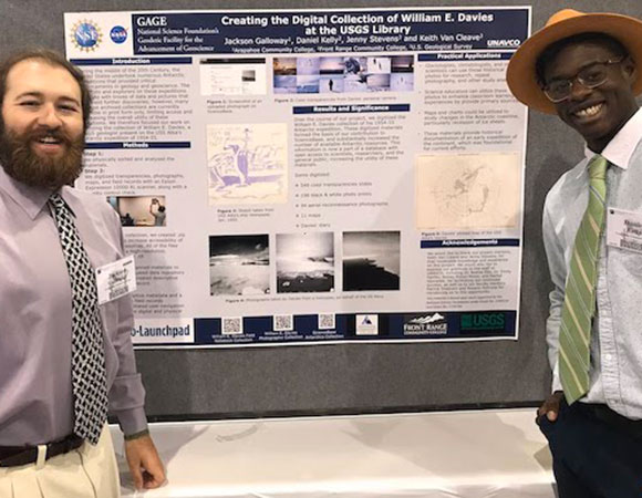 Jackson Galloway (left) and Daniel Kelly (right) are all smiles while presenting their poster at the GSA annual meeting in Phoenix, AZ. (Photo/Patrick Shabram, Front Range Community College)