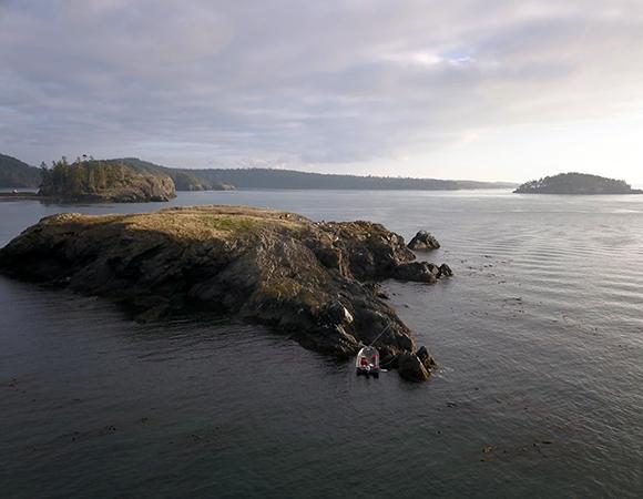P438 - UAV aerial photo of the island looking south. (Photo/Chad Pyatt, UNAVCO)
