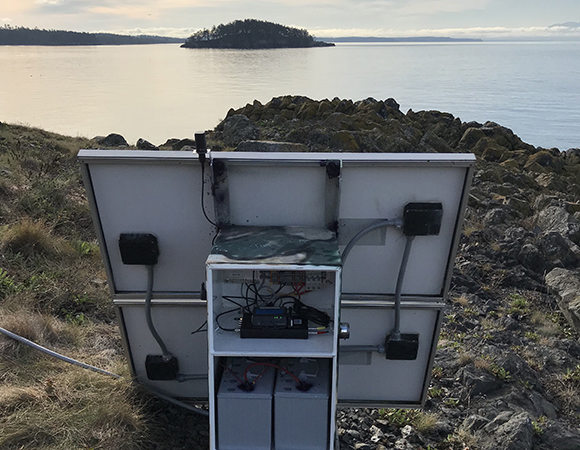 The new enclosure, batteries and GNSS equipment. Ken Austin was able to re-use the existing concrete pad left over from the original PANGA install. (Photo/Liz Van Boskirk, UNAVCO)