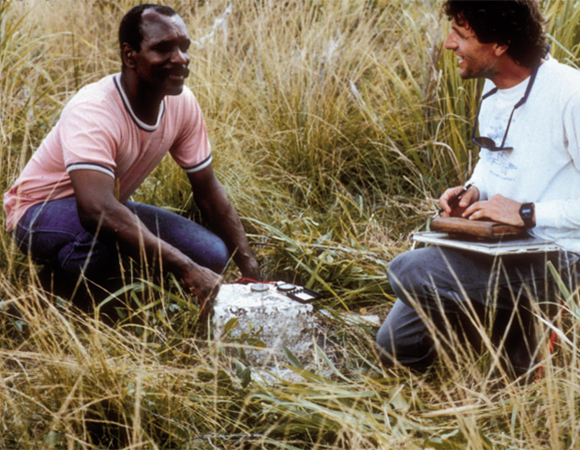 Murchison Pierre (Trinidad-Tobago government surveyor) and John Weber examine a Tobago historic (1920s) survey pillar during 1990s reconnaissance and GPS occupation of Trinidad-Tobago's historic triangulation networks. (Image provided by John Weber, Grand Valley State University)
