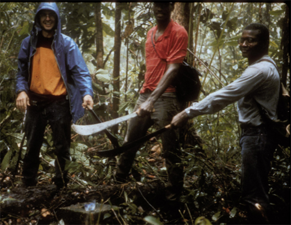 John Weber, William Ambeh, and Stephen Williams (local guide) recovering one of Trinidad's historic (1901-03) mountaintop survey pillars during 1990s reconnaissance and GPS occupation of Trinidad-Tobago's historic triangulation networks. (Image provided by John Weber, Grand Valley State University)