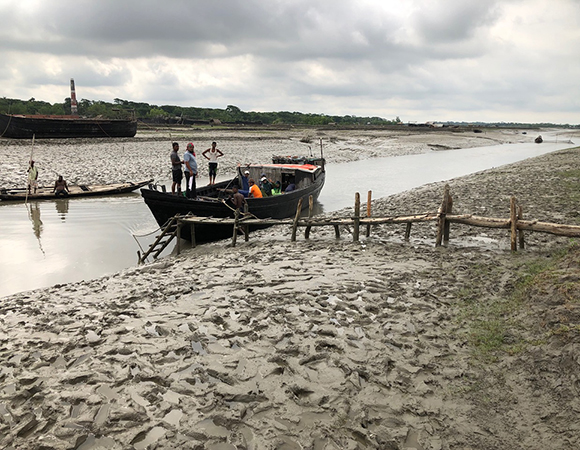 The upper reaches of tide channels became too shallow for the Bawali charter boat, so the team hired a smaller cargo craft close to a village named Baintala. (Photo/John Galetzka, UNAVCO)