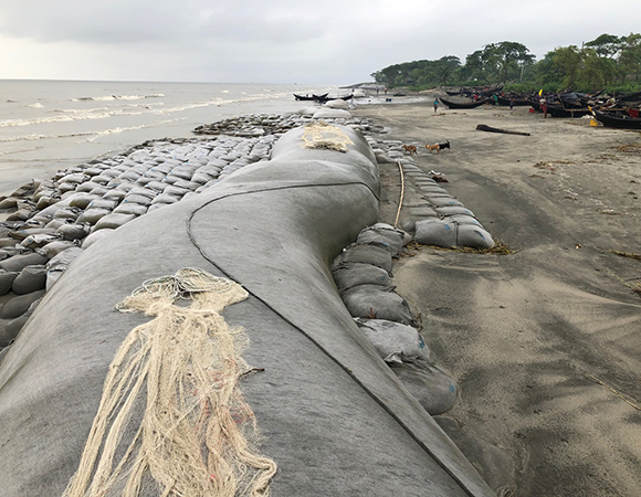 Long, giant sandbags along the coast of the Bay of Bengal at Kuakata, Bangladesh try to slow land erosion caused by subsidence of the delta and sea level rise. (Photo/John Galetzka, UNAVCO)