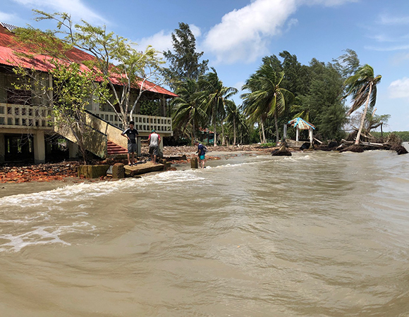 Facing the Bay of Bengal, the Sarangkhola ranger station in the Sundarbans is slowly being washed away because of rising sea level and subsidence of the delta. (Photo/John Galetzka, UNAVCO)