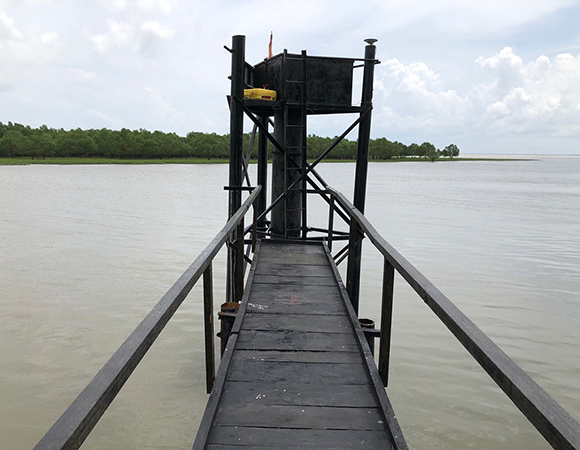 The GNSS team took the opportunity to put a GNSS monument on the tide gauge structure at Hiron Point in the Sundarbans and occupy it for several hours (note the GNSS antenna on the top of the right column).  Data from tide gauges in the delta sometimes show unusual signals which could be caused by unstable tide gauge structures. (Photo/John Galetzka, UNAVCO)