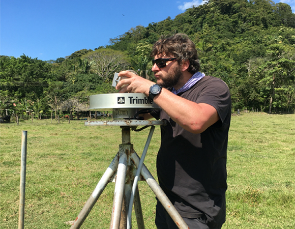 UNAVCO engineer Nicolas Bayou upgrades station QSEC's Trimble Chokering LNA to enable GNSS tracking with the Trimble NetR9 receiver installed at the station. (Photo/Jim Normandeau, UNAVCO)