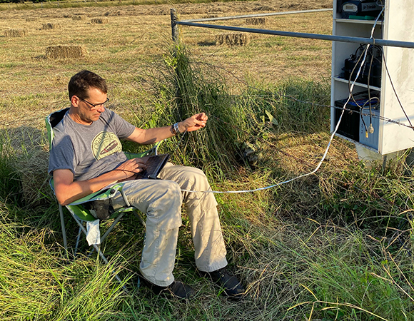 UNAVCO project manager Jim Normandeau troubleshoots communications at station LEPA. (Photo/Nicolas Bayou, UNAVCO)
