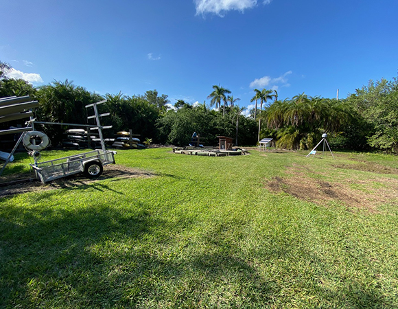 The new Deering Estate County Park GNSS site (FCDE) will experience flooding during King Tides—note the dead grass from the previous inundation. (Photo/John Galetzka, UNAVCO)