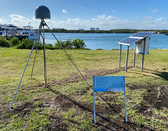 The new GNSS station at Haulover County Park. All the new stations have an interpretive sign for curious passersby. (Photo/John Galetzka, UNAVCO)