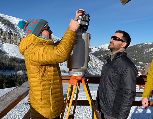 Peter Ottsen (left), Kevin Hammonds (middle), and Sean Yaw (right) set the VZ-6000 up for the first scan from the balcony of the American Spirit Lift at the Yellowstone Club, MT. (Photo/Keith Williams, UNAVCO)