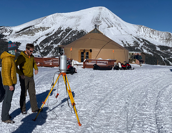 Peter and Sean set up for a second scan at the Yellowstone Club, MT with the Roaming Bison hut and Lone Peak in the background. (Photo/Keith Williams, UNAVCO)