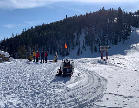 The MSU crew, done scanning, wait on the second snowmobile with the sled to haul the gear back down the mountain at the Yellowstone Club, MT. (Photo/Keith Williams, UNAVCO)