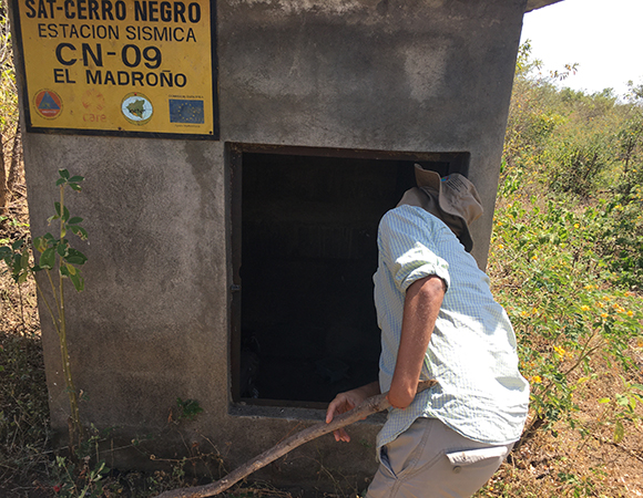 Every seismic bunker had to be searched for scorpions, snakes, wasps, etc. before working inside. (Photo from Jim Normandeau, UNAVCO)