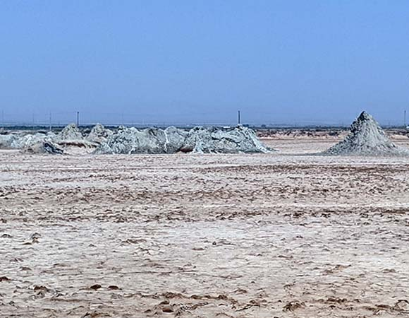 Photo from February 2020 of old geothermal mud pots and mud volcanoes near Calipatria, CA, on the southern end of the Salton Sea, 15 miles north of Westmorland, CA. (Photo by Sean Malloy, UNAVCO)