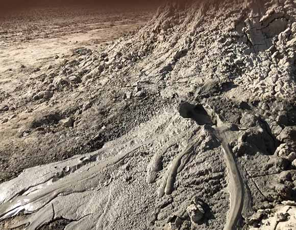 Gurgling vent with mudflows of approximately 1meter/minute in December 2017.  (Photo by Chris Walls, UNAVCO)