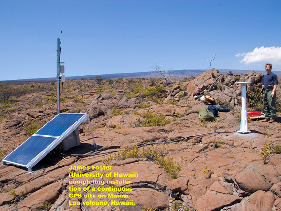 James Foster (University of Hawaii) completing installation of a continuous GPS site on Mauna Loa volcano, Hawaii. The site photograph is courtesy of UNAVCO.