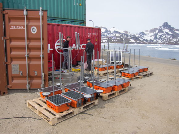 Staging and preparations for deploying sensors on Helheim Glacier. Photo taken at by Tavi Murray.