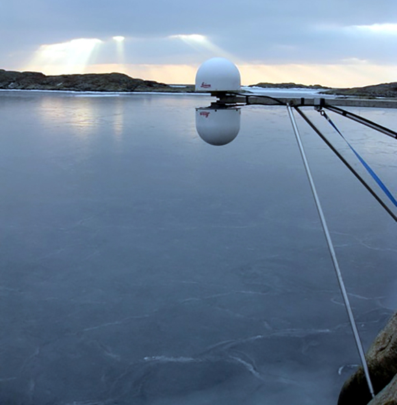 Photograph of the GTGU installation (GNSS site with an antenna facing up and one facing down) on February 6, 2012. At this time, the bay was completely covered by sea ice. Photograph was taken by Johan Löfgren. The photograph is courtesy of the author, J. Strandberg.