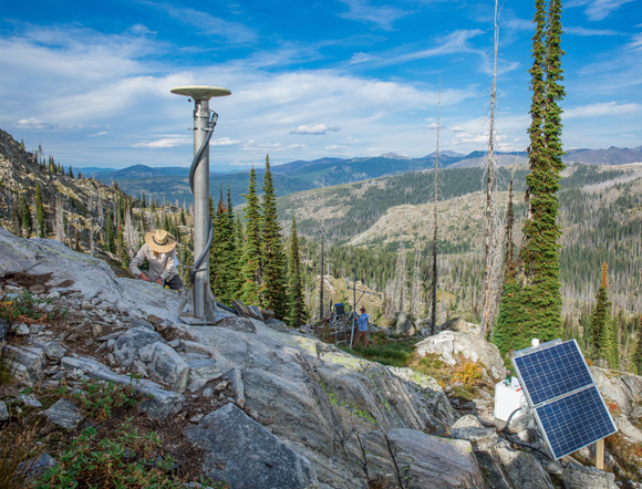 Payton Gardner and Ellen Knappe of the University of Montana, installing a new GPS and weather station (site Beaver Ridge, XBEV) in the Selway-Lochsa Wilderness (near where the Selway and Lochsa rivers meet, close to the Montana-Idaho border; the area represents an important regional watershed), September 2019. Photo Credit: Noah Clayton, University of Montana.
