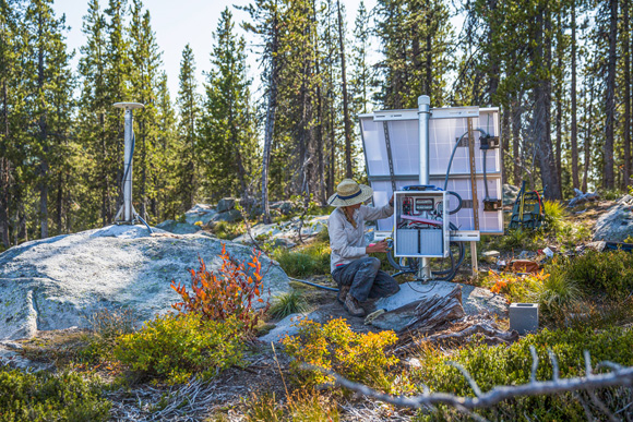 Ellen Knappe, University of Montana, adding the final touches to another new GPS station (Tom Beal Peak, XTOM) in the Selway-Lochsa Wilderness, September 2019. Photo Credit: Noah Clayton, University of Montana.