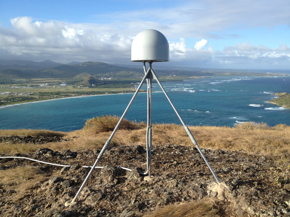 Photograph of radome covering the antenna which is cabled to the receiver in an instrument enclosure (not shown) for GPS/GNSS COCONet site, CN47 on Saint Lucia Island in the Caribbean. Photograph by Mike Fend/UNAVCO.