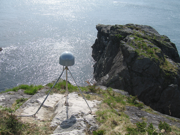 Photograph of GPS antenna at GPS station AB43, near Cape Spencer, Alaska. Credit: UNAVCO.
