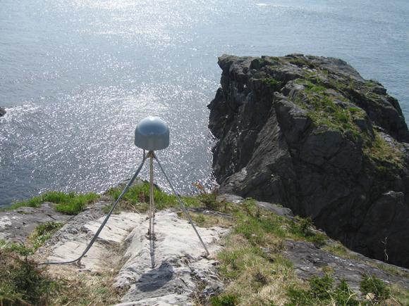 Photograph of GPS antenna at GPS station AB43, near Cape Spencer, Alaska. Credit: UNAVCO.