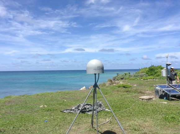 Installation of GPS/meteorologic station, CN18, on Swan Islands, Honduras. UNAVCO Field Engineer Michael Fend by the instrument box. Credit: John Sandru, COCONet and UNAVCO.
