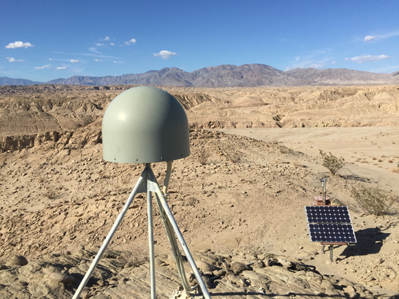 View of GPS station antenna and instrument box for Plate Boundary Observatory site P487 near Borrego Springs in southern California. Photo taken by Christian Walls/UNAVCO.