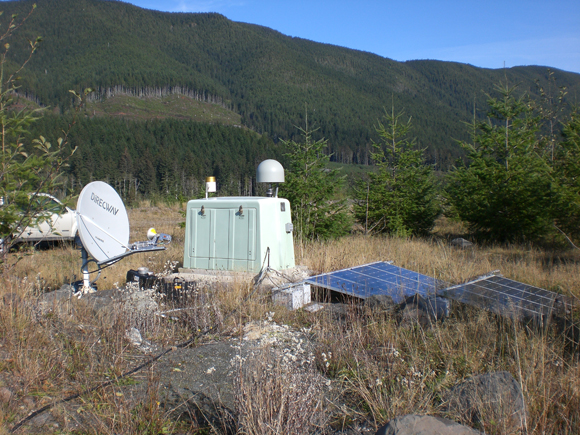 Borehole geophysical site, B003, at Floe Quarry, Washington. The site includes a downhole strainmeter, seismometer, temperature sensor and pore pressure transducer. Communications, power supplies, a meteorological instrument and GPS station P403 at the surface complete the site. The strainmeter data from this site and B004 was utilized in the analysis of the RTRs. The site is part of the EarthScope Plate Boundary Observatory operated and maintained by UNAVCO. The site photograph is courtesy of UNAVCO.