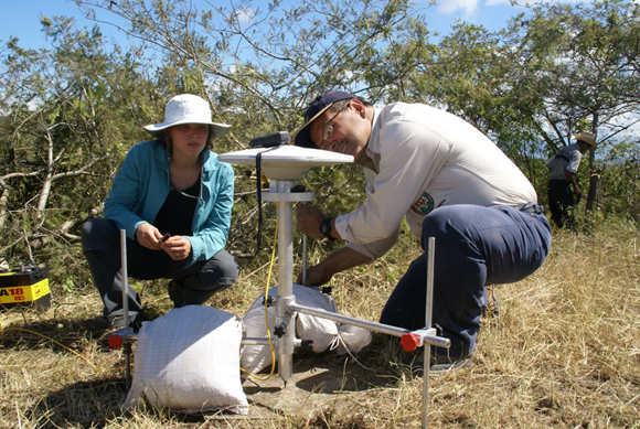 Author Andria Ellis and co-author Omar Flores installing campaign GPS equipment for a 72-hour occupation at site SAN0 in Guatemala in 2012. Photo credit: Neal Lord, University of Wisconsin, Madison. Photograph is courtesy of the author, A. Ellis