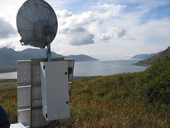 Photograph of the communications on top of the enclosure with the receiver and other instruments for GNSS site AC34, located at Old Harbor on Kodiak Island, Alaska. Data from this site was used in this study. Photograph is courtesy of UNAVCO/David Kasmer.