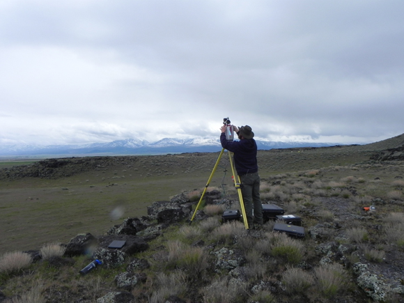 UNAVCO field engineer John Sandru setting up the terrestrial laser scanner, TLS; also known as terrestrial lidar scanner, at Tabernacle Hill, an 18 ka old basalt flow near Fillmore, Utah. The TLS scan revealed previously unidentified lake benches and collapsed lava tubes deformed by the Tabernacle Fault. Photo by Tim Stahl, 2016.