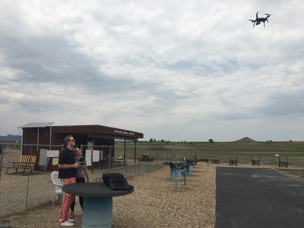 Two USIP interns learning to fly a drone.