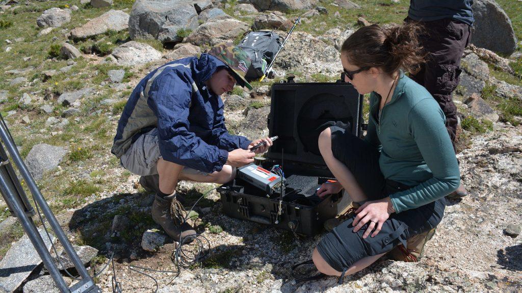 Two GLP interns using GPS equipment