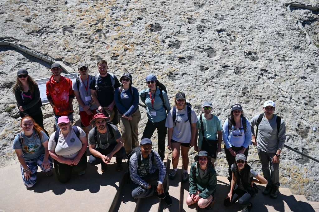 group photo in front of dinosaur tracks