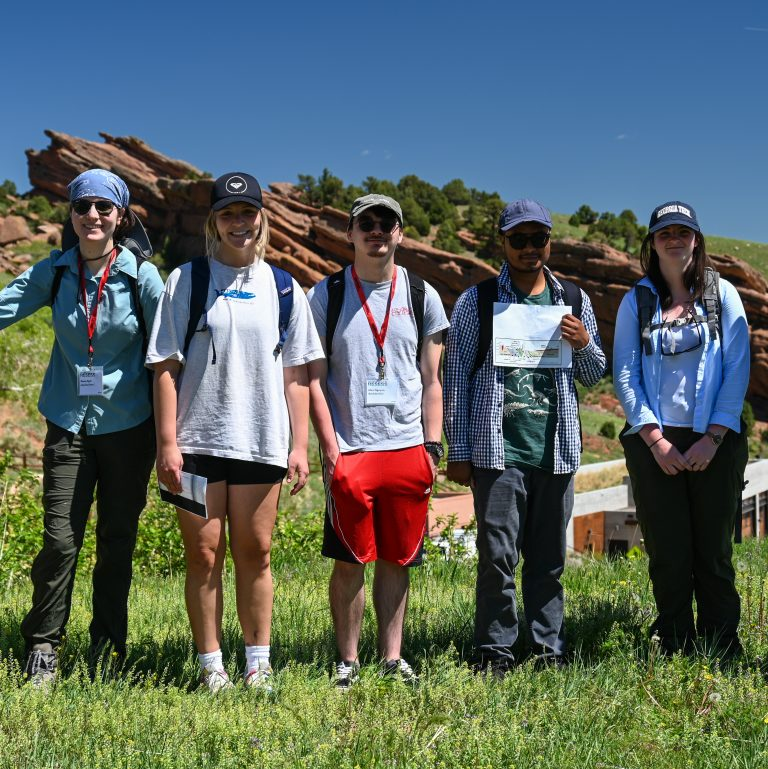 Five of the 2021 RESESS interns at Red Rocks Park in Morrison, CO.