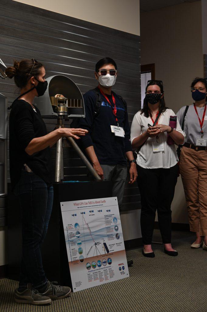 interns listening to description of gps display instrument