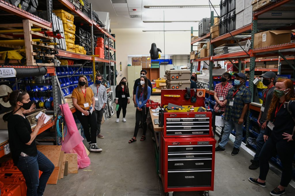 interns gathered in workshop area on tour
