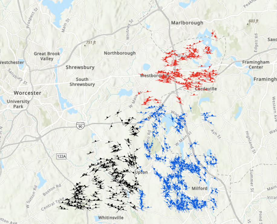 Map of Massachusetts with symbols at different angles representing the dips of the foliations in the locations. Blue symbols represent Milford Avalon Foliations, black symbols represent Grafton Avalon Foliations, and red symbols represent Marlborough Foliations.