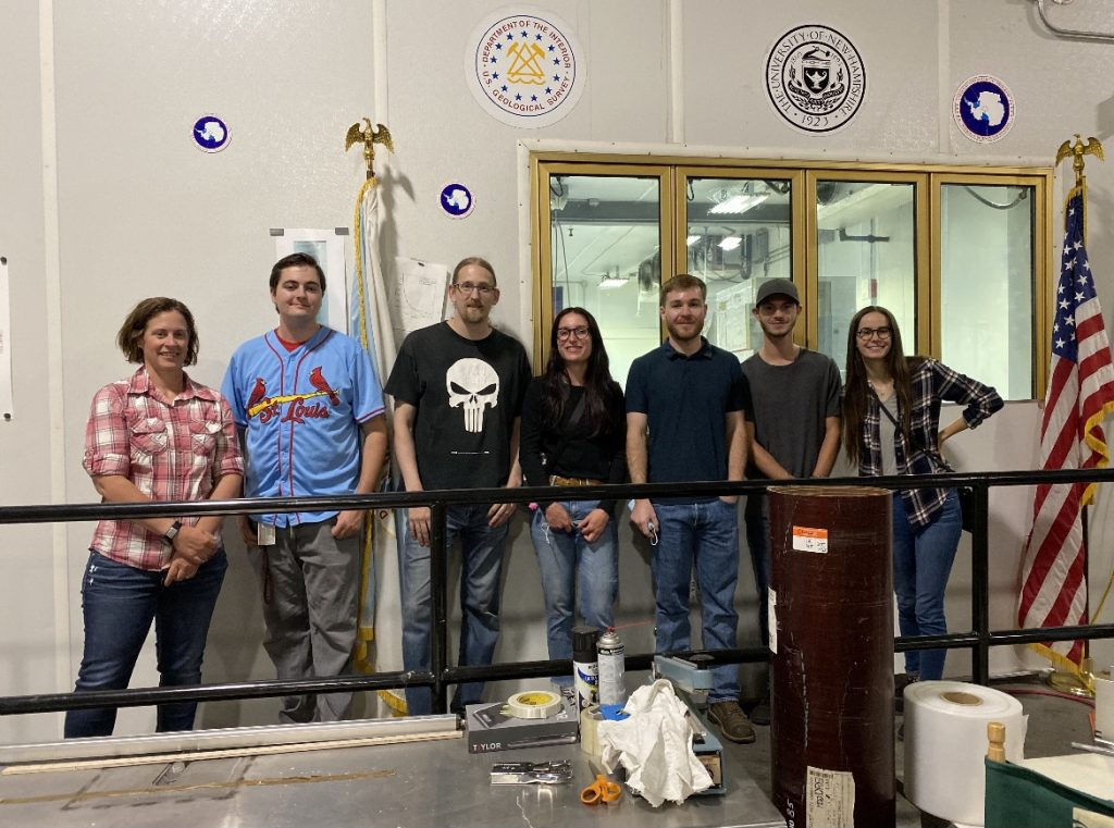 Mentor Mikki Johnson, two NSF Ice Core Facility employees, and the Geo-Launchpad Interns (Madalyn Massey, Patrick Walston, Jimmy Swift, and Allison Sowers) smiling for a picture before leaving the NSF Ice Core Facility.