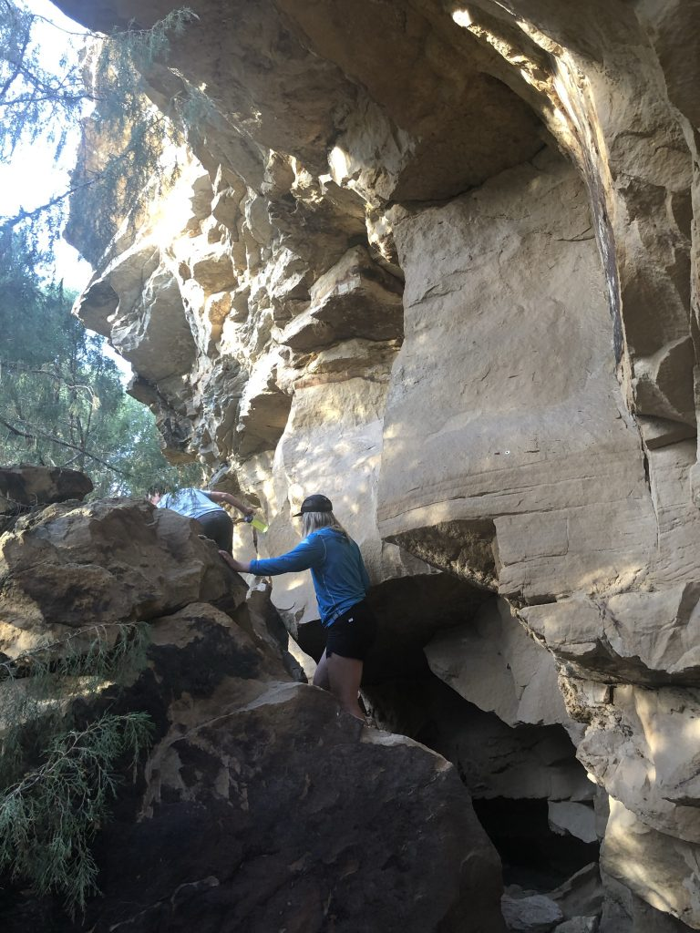 Skye Fernandez (RESESS) climbing an outcrop.