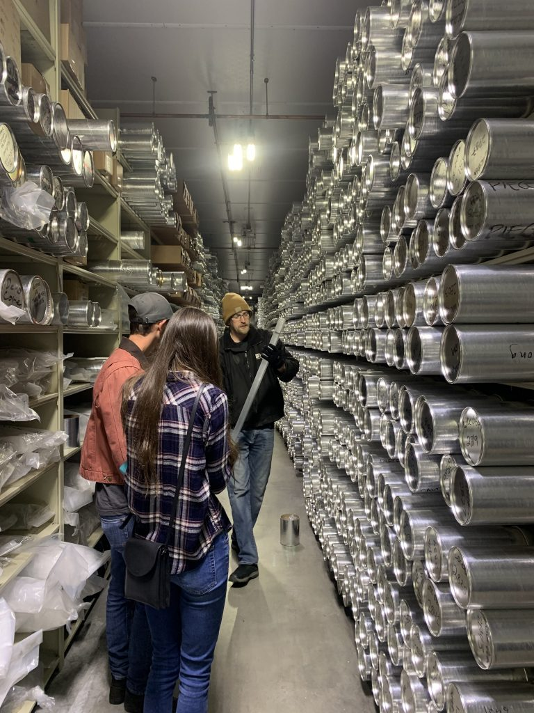 Richard Nunn showing ice cores to Geo-Launchpad Interns Jimmy Swift and Allison Sowers in the NSF Ice Core Facility.