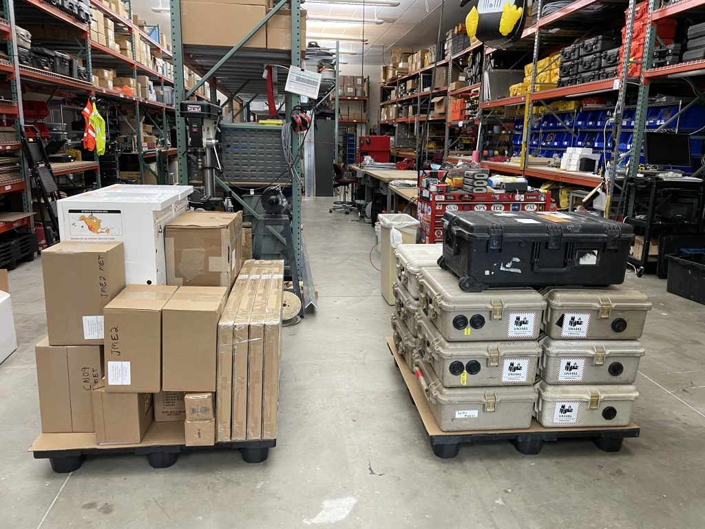 boxes and cases stacked on pallets